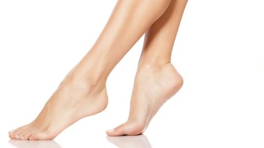 beautiful women's feet on white background